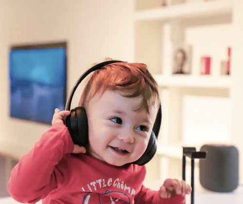 cute-toddler-with-headphones-listen-uplifting-positive-music-brain-development-music-learning-neuroplasticity-songs-kids